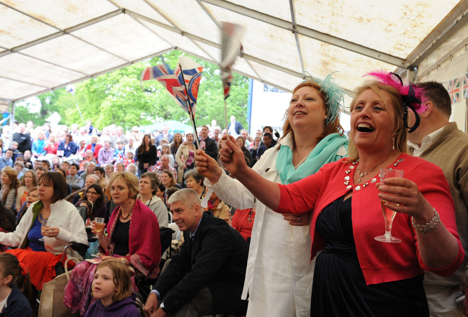 Photo - Jackie Brown and Fiona Lee from Ruislip, right, celebrate the wedding of Britain's Prince William to Kate Middleton in Bucklebury, home of the Middleton family, Friday April 29, 2011. (AP Photo/Hannah Maule-ffinch) ORG XMIT: RWDJ142