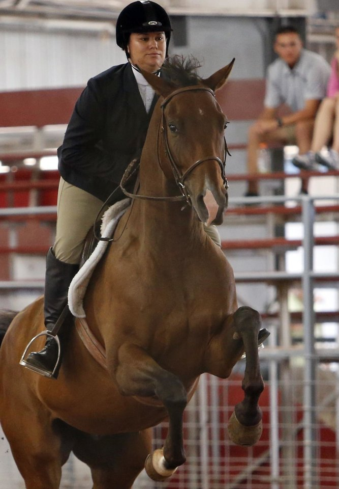 Photo -  Casey Sendek rides Doctor Approved in the Working Hunter Class during the Cleveland County Free Fair Horse Show. PHOTO BY STEVE SISNEY, THE OKLAHOMAN   STEVE SISNEY -