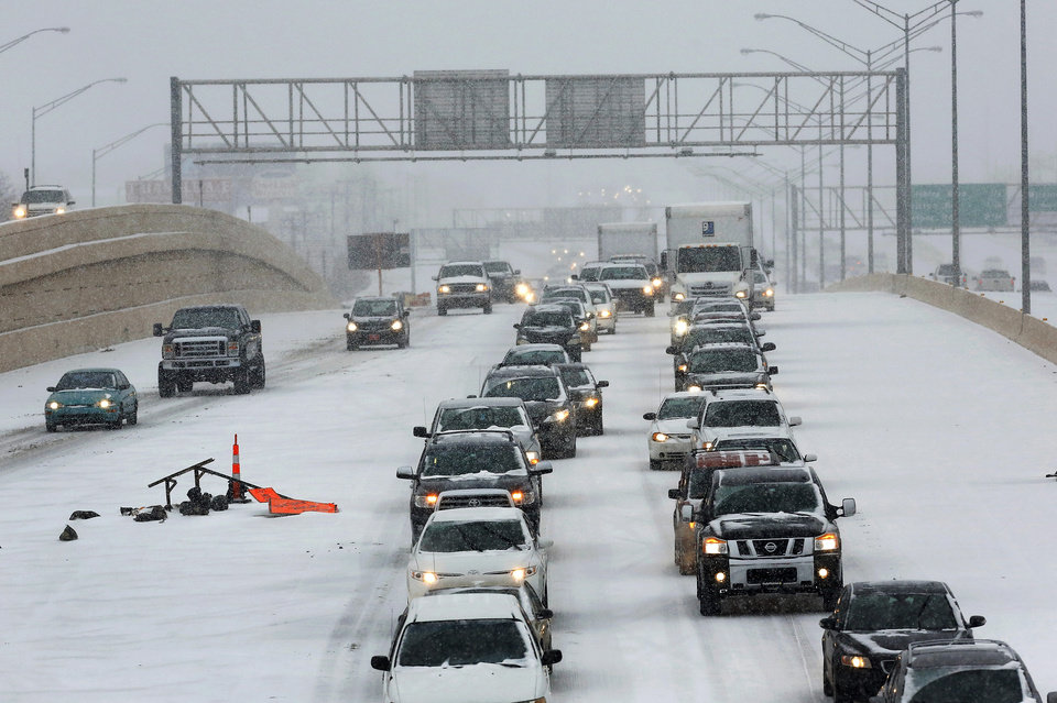 Photo - Traffic on Broadway Extension is slowed as a strong winter storm, bringing snow and ice,  moved across the state and through the metro area Thursday afternoon, Dec. 5, 2013. Photo by Jim Beckel, The Oklahoman
