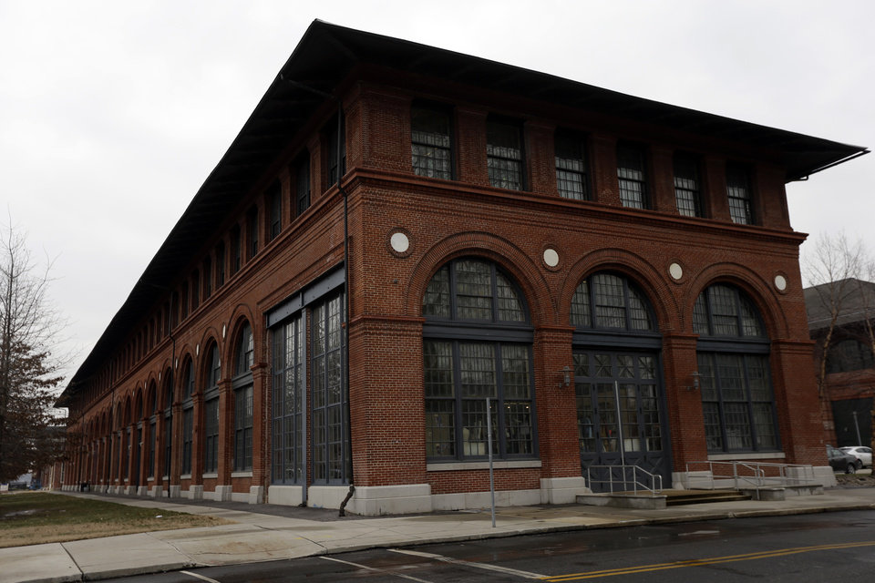 Photo - In this Wednesday, Feb. 6, 2013 photo, shown is an Urban Outfitters building at the Navy Yard in Philadelphia. The city's Navy Yard is celebrating a milestone that skeptics might not have believed 15 years ago. Nearly all naval operations are long gone from the sprawling former shipyard but 10,000 people now work there in an eclectic mix of businesses from fashion to pharmacies. That number is expected to triple in 20 years. (AP Photo/Matt Rourke)
