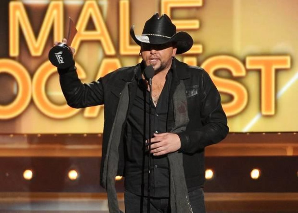 Photo -  Jason Aldean accepts the award for male vocalist of the year at the 49th annual Academy of Country Music Awards at the MGM Grand Garden Arena on Sunday, April 6, 2014, in Las Vegas. (AP)