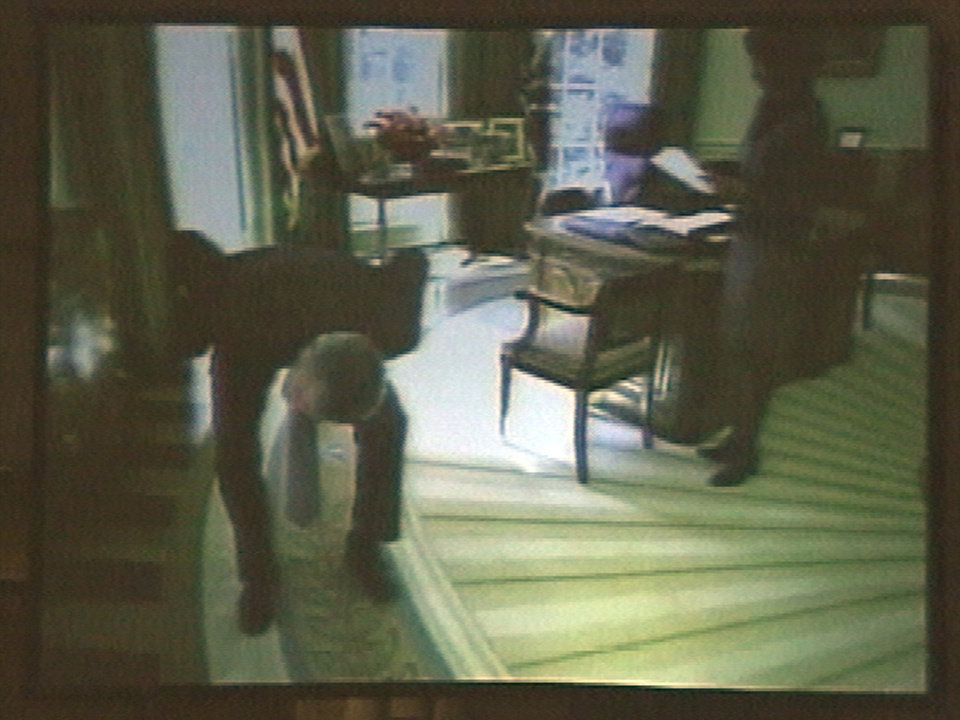Photo -   FILE - In this March 24, 2004, file photo taken from video, President George W. Bush appears to search the Oval Office for weapons of mass destruction in a spoof video shown at the White House radio and television correspondents dinner in Washington. Bush narrated the video at the dinner and quipped,