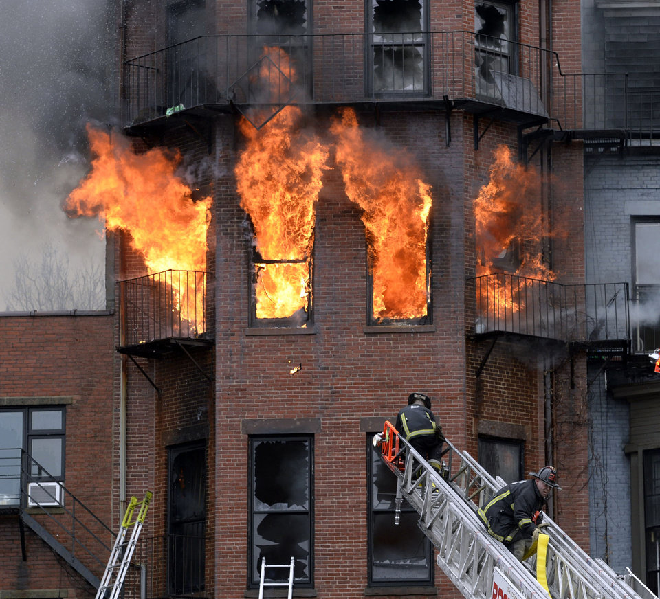 Photo - Boston firefighters work a multi-alarm brownstone fire, Wednesday, March 26, 2014, in Boston. A Boston city councilor said two firefighters have died in a fire that ripped through the brownstone. (AP Photo/The Boston Herald, Christopher Evans) BOSTON GLOBE OUT; METRO BOSTON OUT; MAGAZINES OUT; ONLINE OUT.