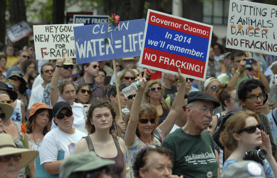 Photo - Protesters rally against hydrofracking at the Capitol in Albany, N.Y., on Monday, June 17, 2013.    They are urging Gov. Andrew Cuomo to permanently ban hydraulic fracturing for natural gas in New York, saying it will harm the environment. (AP Photo/Tim Roske)