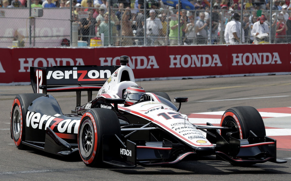 Photo - Will Power, of Australia, drives through Turn 10 during qualifying for IndyCar series Honda Grand Prix of St. Petersburg auto race Saturday, March 23, 2013, in St. Petersburg, Fla. Powers took the pole position for Sunday's race. (AP Photo/Chris O'Meara)