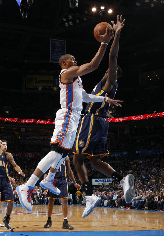 Photo - Russell Westbrook (0) shoots a lay up during the NBA game between the Indiana Pacers and the Oklahoma City Thunder at the Chesapeake Energy Arena   Sunday,Dec. 9, 2012. Photo by Sarah Phipps, The Oklahoman