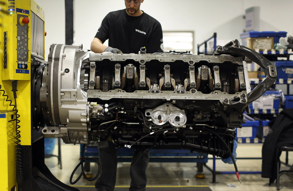 Photo - In this March 26, 2014 picture, Jon Wyand works on a truck engine assembly line at Volvo Trucks' powertrain manufacturing facility in Hagerstown, Md. Recent goods news on manufacturing and hiring has boosted confidence in the economy. Manufacturing is expanding at a healthy pace and the service industry continues to grow, according to surveys released by the Institute for Supply Management earlier this month. (AP Photo/Patrick Semansky)