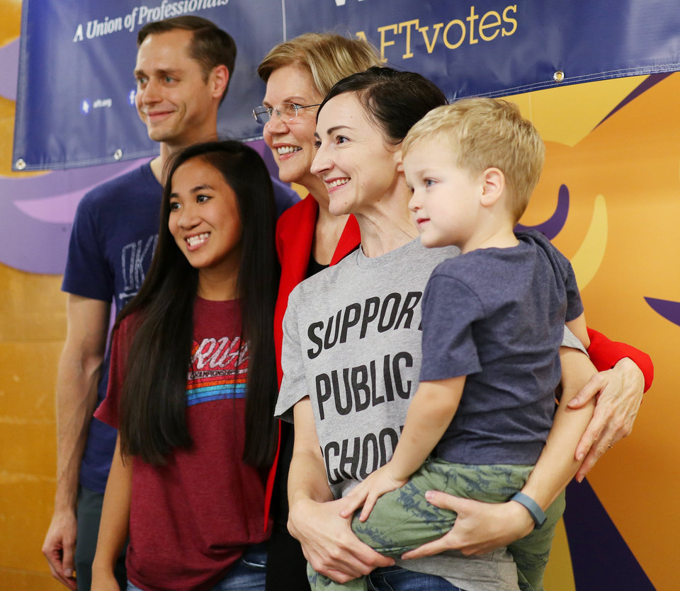 Photo -  U.S. Sen. Elizabeth Warren, gets a photo Saturday with, from left, Nick Singer, Gabby Singer, 14, Jackie Singer and Ethan Singer, 3, after the rally. [Photo by Doug Hoke, The Oklahoman]