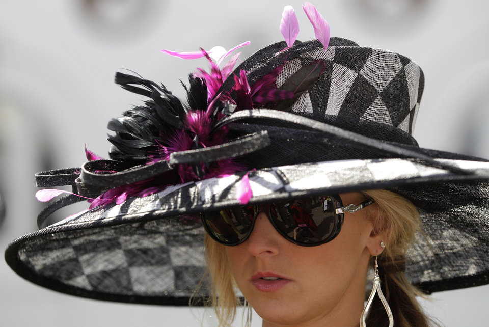 Photo - Sara Boucher, Frederickstown, Ohio wears a fancy hat in the paddocks before the 138th Kentucky Derby horse race at Churchill Downs Saturday, May 5, 2012, in Louisville, Ky. (AP Photo/Mark Humphrey)  ORG XMIT: DBY125