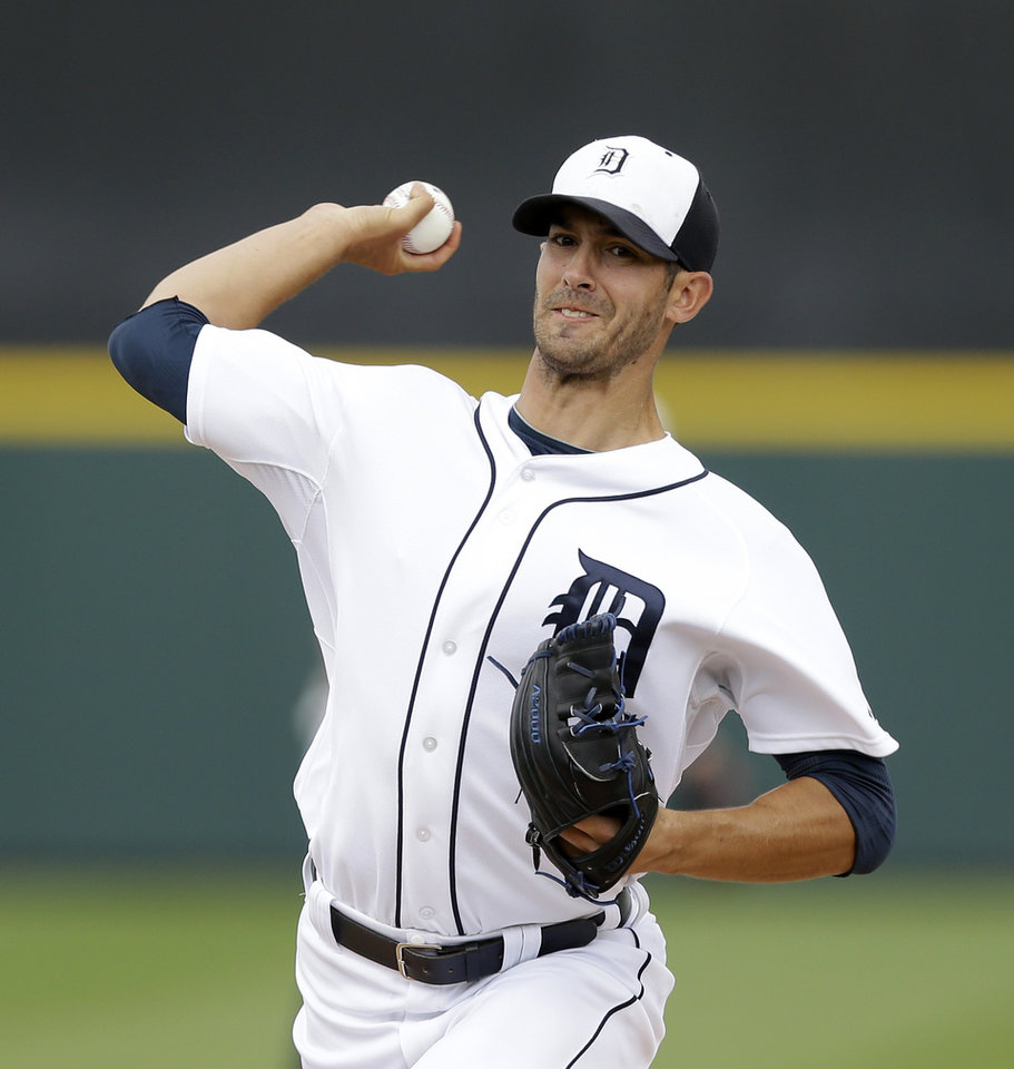 Photo - Detroit Tigers starting pitcher Rick Porcello throws during the first inning of a spring exhibition baseball game against the Atlanta Braves in Lakeland, Fla., Tuesday, March 25, 2014. (AP Photo/Carlos Osorio)