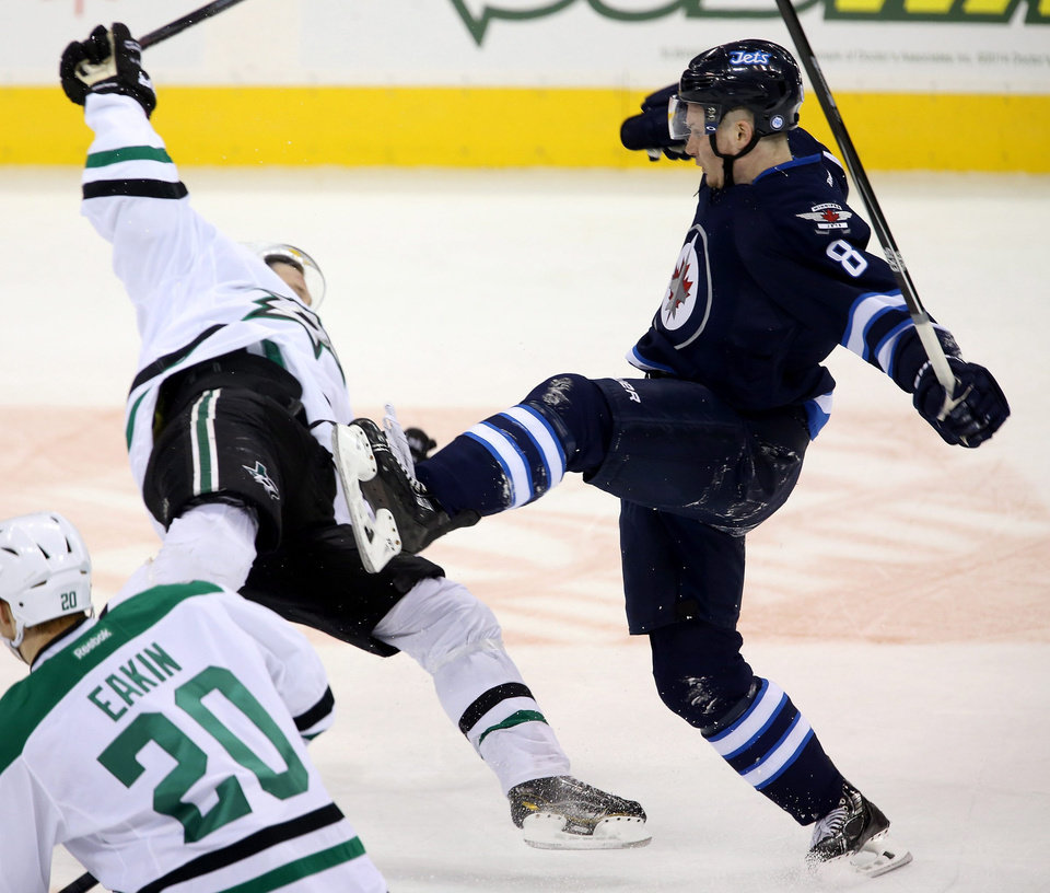 Photo - Dallas Stars' Erik Cole (72) is flattened by Winnipeg Jets' Jacob Trouba (8) during first period NHL action at the MTS Centre in Winnipeg, Manitoba,  Sunday, March 16, 2014. (AP Photo/The Canadian Press, Trevor Hagan)