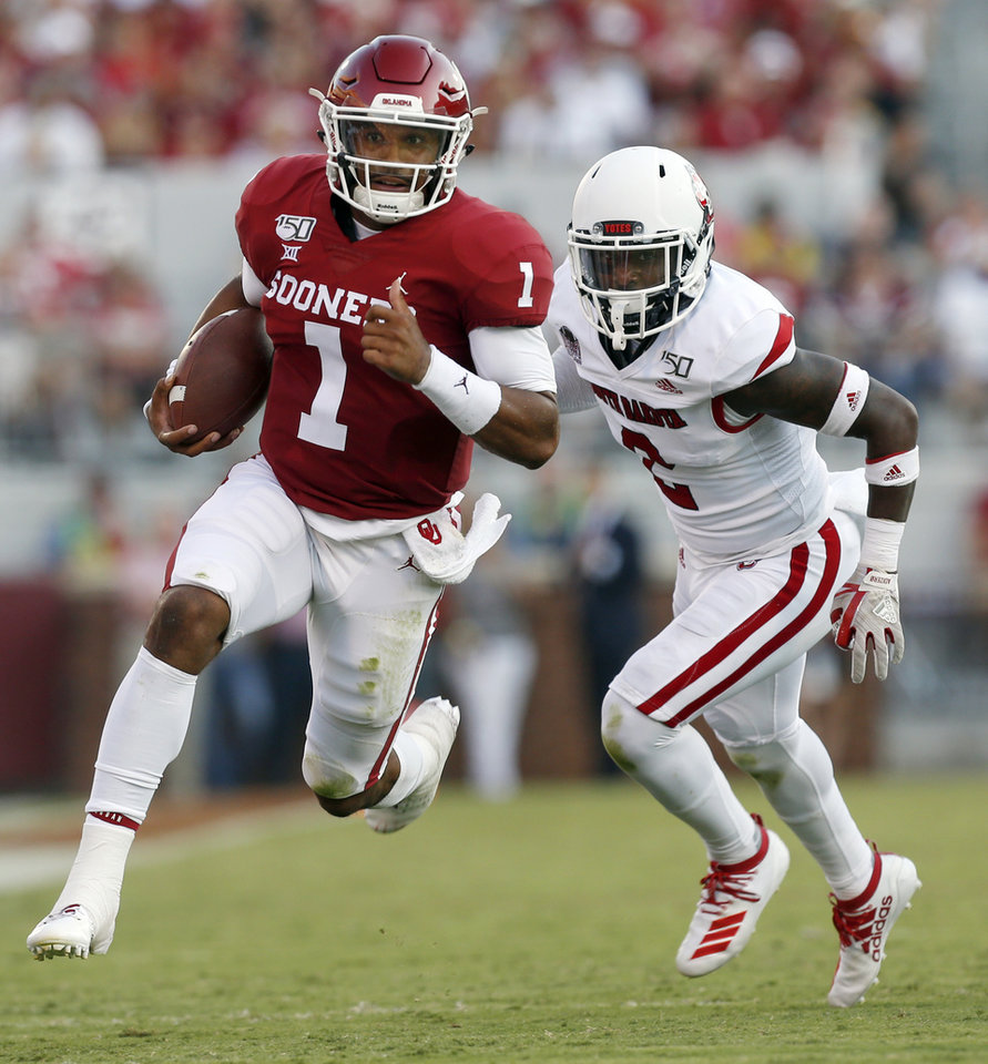 Photo - Oklahoma's Jalen Hurts (1) carries the ball away from South Dakota's Mike Johnson (2) in the second quarter during a college football game between the Oklahoma Sooners (OU) and South Dakota Coyotes at Gaylord Family - Oklahoma Memorial Stadium in Norman, Okla., Saturday, Sept. 7, 2019. [Nate Billings/The Oklahoman]