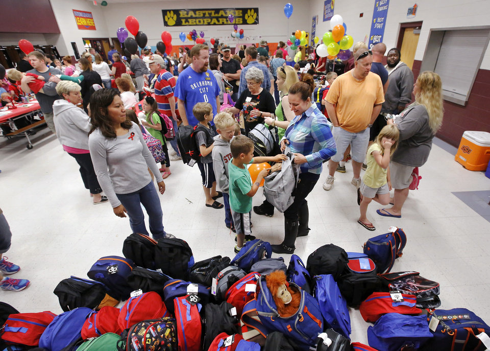 Children were asked to select a new backpack from among several hundred that had been provided. There was lots of hugging and plenty of joy at Eastlake Elementary School on SW 134, when Eastlake School hosted a reunion of students, parents, teachers and families from Plaza Towers Elementary School on Thursday, May 23, 2013. Seven students died at Plaza Towers School in Monday's EF-5 tornado, which also destroyed the school.  Photo  by Jim Beckel, The Oklahoman.