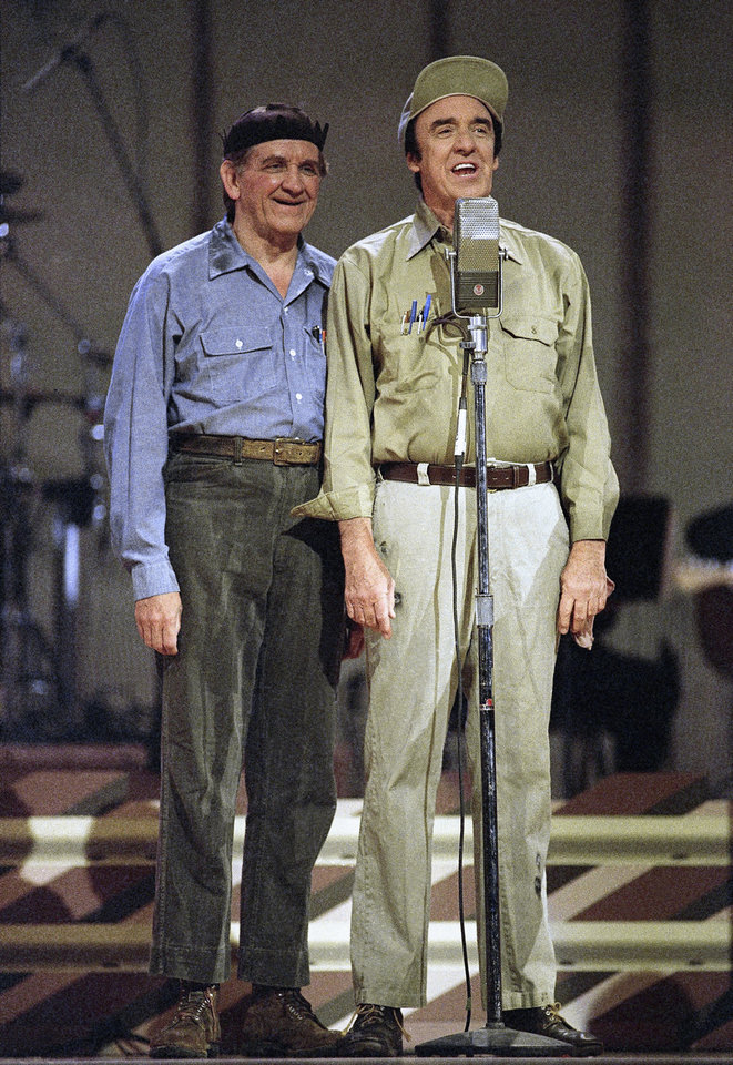This May 1992 photo provided by the The Andy Griffith Show shows Jim Nabors, right, with George Lindsey. Lindsey, who spent nearly 30 years as the grinning Goober , has died, Sunday, May 6, 2012. He was 83. (AP Photo/The Andy Griffith Show) ORG XMIT: NY119