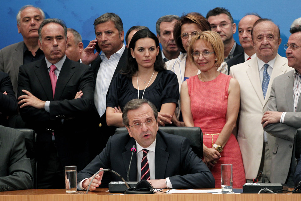 Photo -   Leader of the New Democracy conservative party Antonis Samaras, center, speaks during a press conference in Athens, Sunday, June 17, 2012. The pro-bailout New Democracy party came in first Sunday in Greece's national election, and its leader has proposed forming a pro-euro coalition government.(AP Photo/Petros Giannakouris)