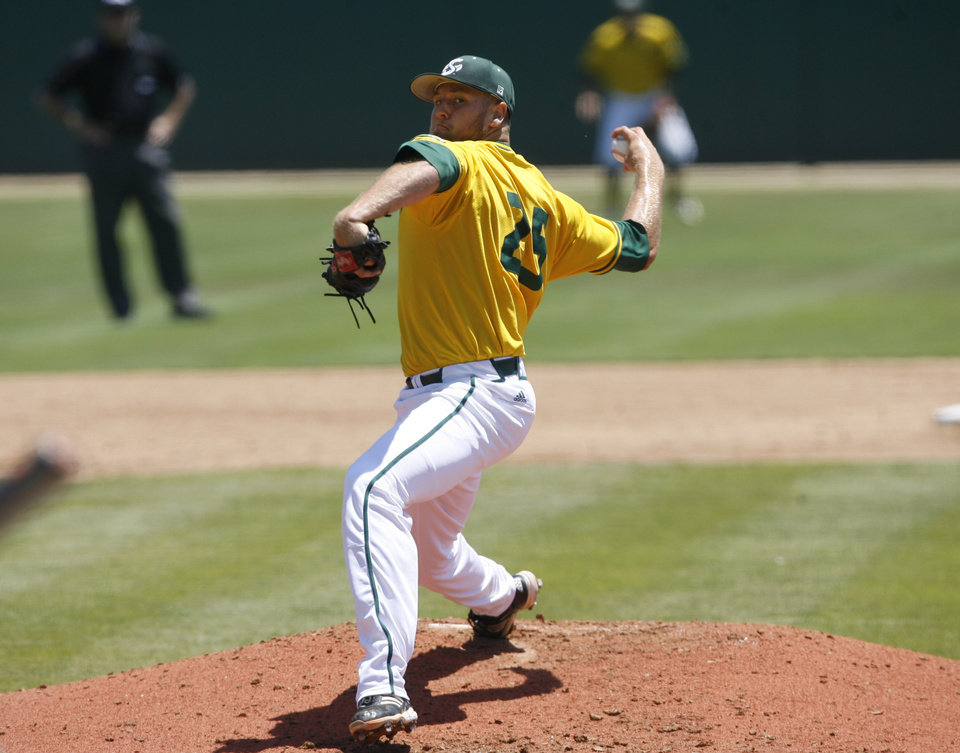 Photo - Sacramento State pitcher Justin Dillon delivers during the second inning of an NCAA college baseball tournament regional game against Cal Poly on Sunday, June 1, 2014, in San Luis Obispo, Calif. (AP Photo/Aaron Lambert)