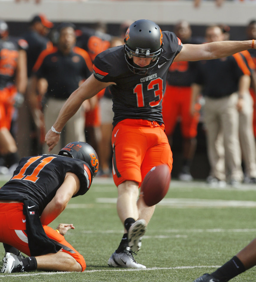 Photo - Oklahoma State's Quinn Sharp (13) kicks an extra point during a college football game between the Oklahoma State University Cowboys (OSU) and the University of Kansas Jayhawks (KU) at Boone Pickens Stadium in Stillwater, Okla., Saturday, Oct. 8, 2011 Photo by Steve Sisney, The Oklahoman