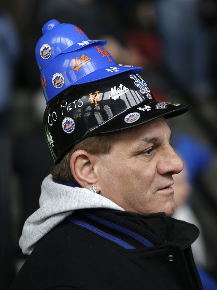 Photo - New York Mets' fan Phil Alessi arrives before the baseball game between the Mets and the Washington Nationals on opening day at Citi Field in New York, Monday, March 31, 2014.  (AP Photo/Seth Wenig)