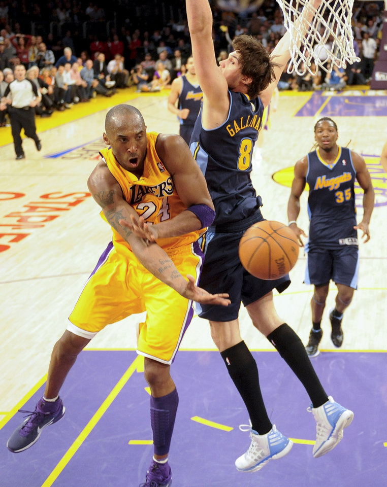 Photo -   Los Angeles Lakers' Kobe Bryant, left, passes around Denver Nuggets' Danilo Gallinari during the second half of a NBA first-round playoff basketball game in Los Angeles, Tuesday, May 1, 2012. The Lakers won 104-100. (AP Photo/Chris Carlson)