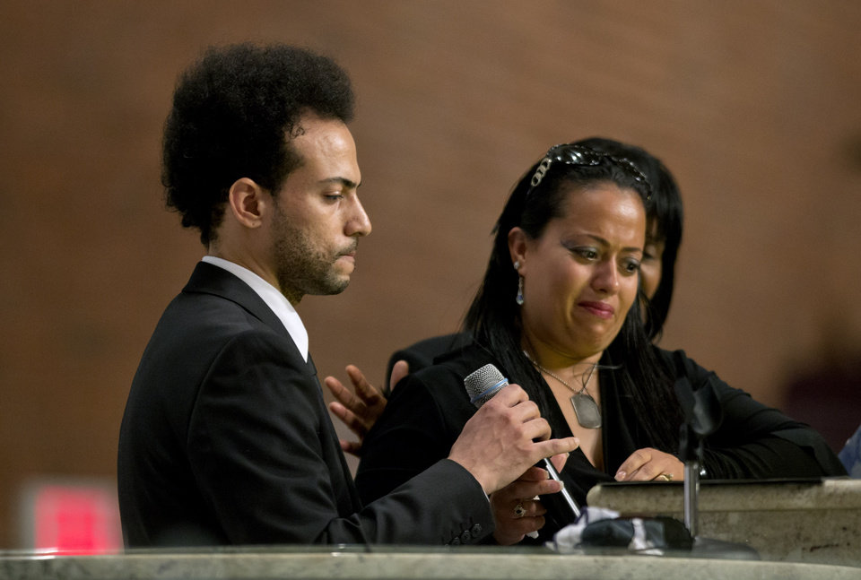 Chris Smith, left, of the rap duo Kris Kross, speaks at the funeral service of fellow band member Chris Kelly, as Smith's sister, Jennifer Smith, right, listens, Thursday, May 9, 2013, in Atlanta. The 34-year-old Kelly was found dead May 1 of a suspected drug overdose. Kriss Kross was introduced to the music world in 1992 by music producer and rapper Jermaine Dupri after he discovered the pair at a mall in southwest Atlanta.  (AP Photo/David Goldman)