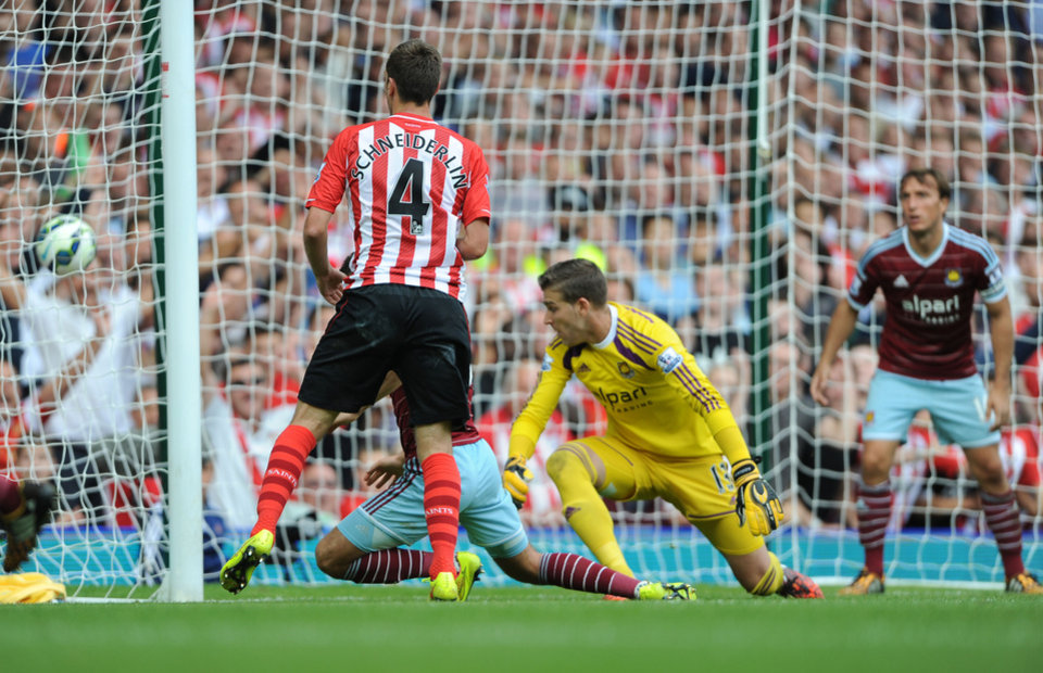 Photo - Southampton's Morgan Schneiderlin scores his team's second goal during their English Premier League soccer match against West Ham United at Upton Park, London, Saturday, Aug. 30, 2014. (AP Photo/Daniel Hambury, PA Wire)     UNITED KINGDOM OUT    -   NO SALES    -    NO ARCHIVES