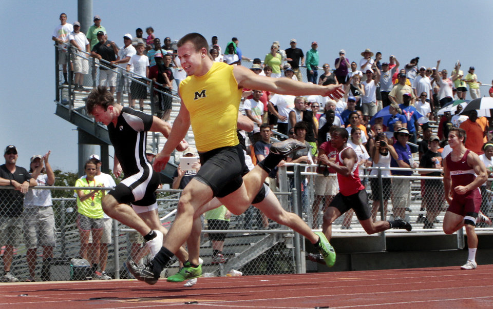 Caleb Muncrief, Madill (yellow jersey) (an Oklahoma State University football commit) wins the 4A 100 meter dash at the state championship track meet on Saturday, May 5, 2012, in Ardmore, Okla. Photo by Steve Sisney, The Oklahoman