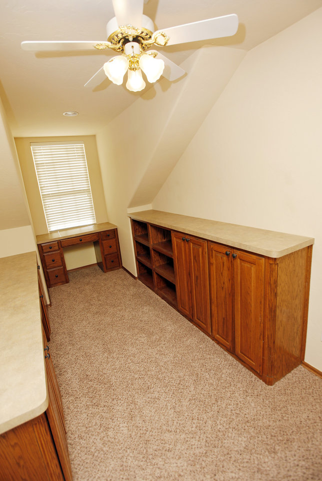 A view of an upstairs room that could be used as an office or game room at 13504 Calistoga Drive, listed by real estate agent Mary Berry, in Oklahoma City, Friday, Dec. 30, 2011. Photo by Nate Billings, The Oklahoman