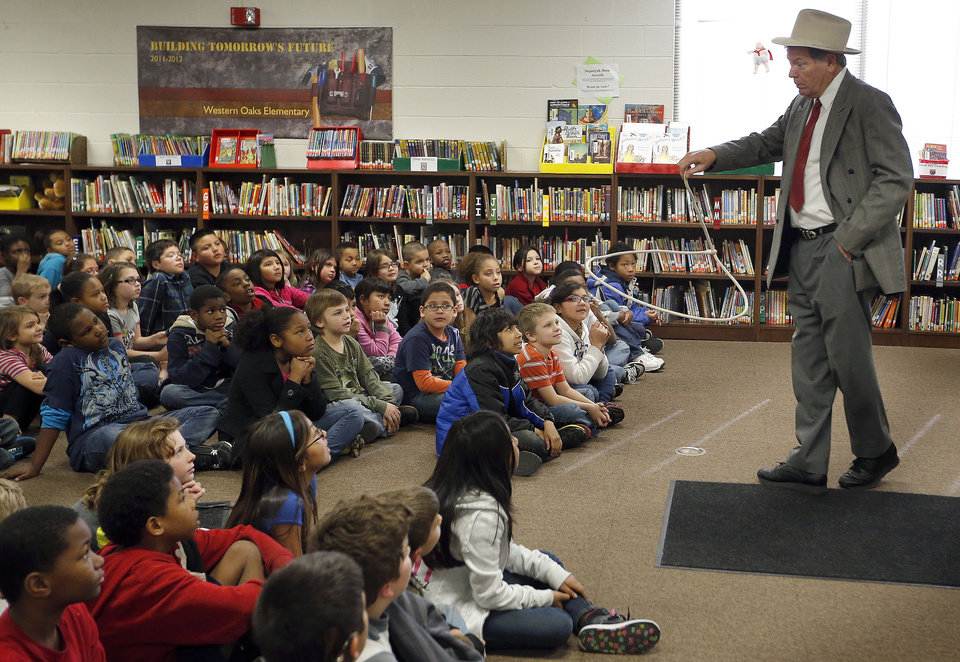 Doug Watson, portraying Will Rogers, does his rope tricks during a presentation for third-graders at Putnam City�s Western Oaks Elementary. PHOTOs BY SARAH PHIPPS, THE OKLAHOMAN