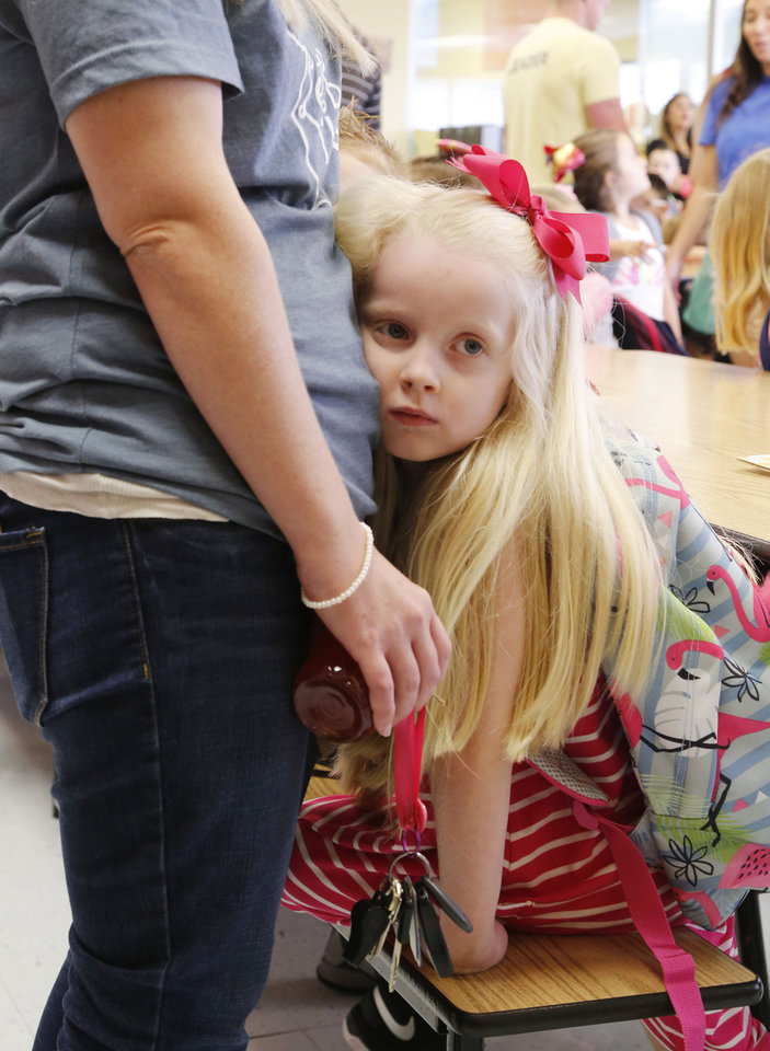 Photo -  Kindergarten student Cobie Price rests her head against her mother, Courtney Price, a third-grade teacher, on the first day of school. [PHOTO BY PAUL HELLSTERN, THE OKLAHOMAN]