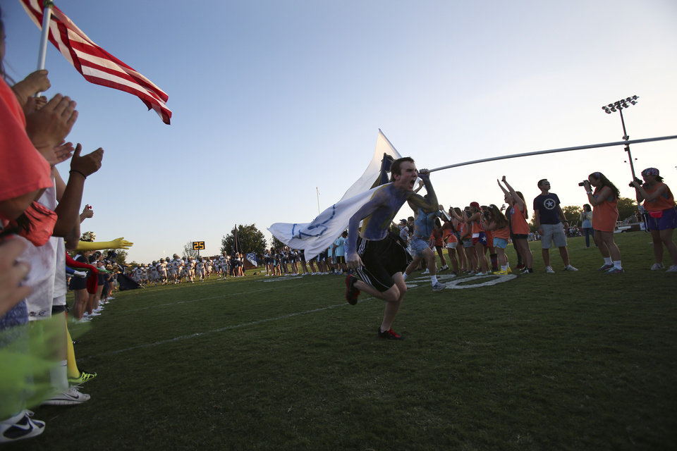Will Snoddy, a junior at Heritage Hall, carries the school colors before a game between Casady and Heritage Hall at Casady High School in The Village, Okla., Thursday, Aug. 30, 2012.  Photo by Garett Fisbeck, The Oklahoman