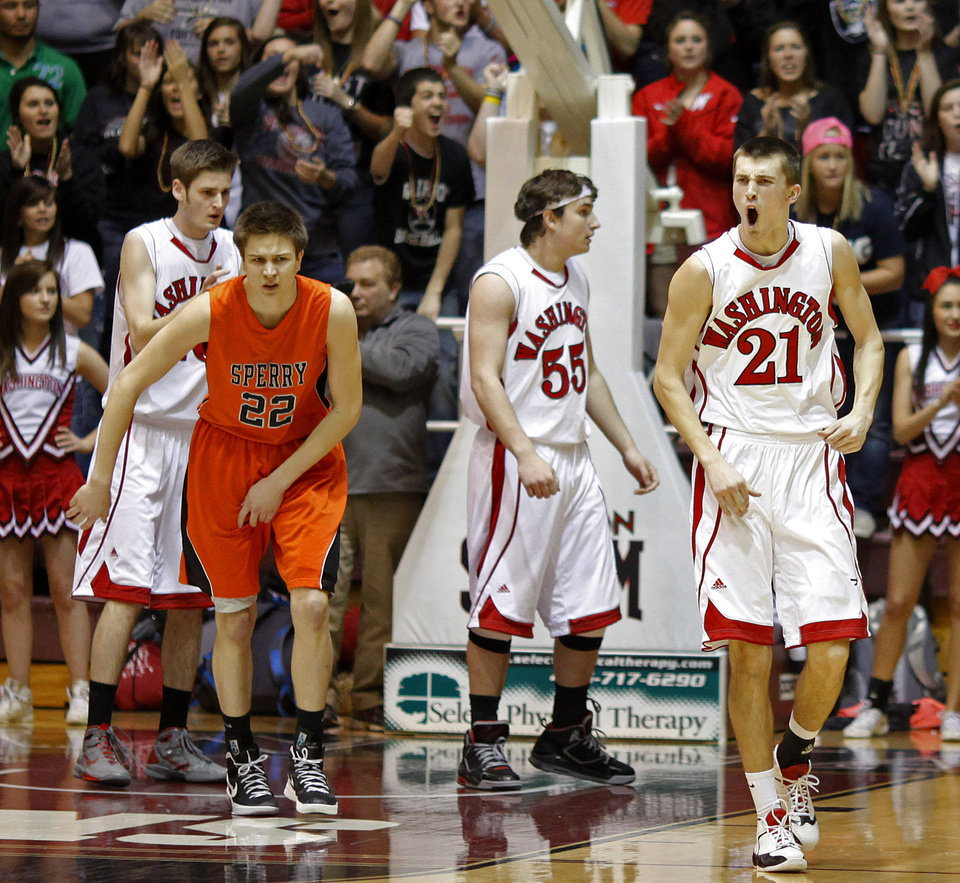 Photo - CLASS 3A HIGH SCHOOL BASKETBALL / STATE TOURNAMENT: Washington's Cal Andrews (21) celebrates beside teammates  Kaden Kirtley (55), and Max Atteberry (40) as  Sperry's Casey Cole (22) looks on during a Class 3A boys basketball state tournament game at Southern Nazarene University in Bethany, Okla., Thursday, March 8, 2012. Photo by Bryan Terry, The Oklahoman