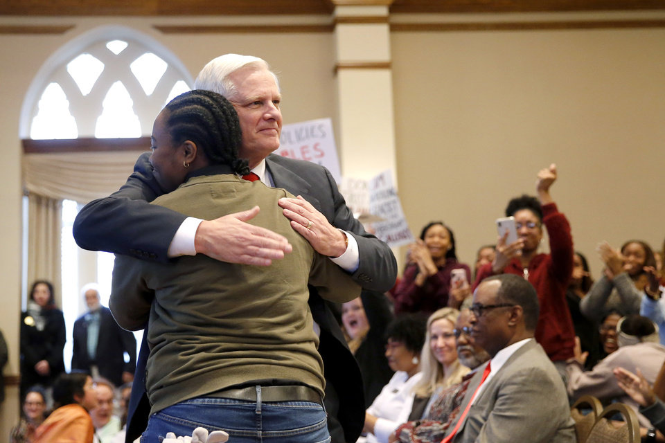 Photo - University of Oklahoma President James Gallogly hugs student Jamelia Reed after Reed spoke to the crowd during a Rally to Stop Racism, hosted by the Black Student Association, on the campus of the University of Oklahoma, Tuesday, Jan. 22, 2019. The rally was in response to a video that surfaced on social media of an OU student in blackface. Photo by Bryan Terry, The Oklahoman
