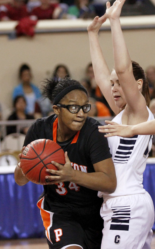 Photo - Preston forward Armahni Shields moves the ball past a Cordell defender during the Class 2A Girls State Championship game between Preston and Cordell at Jim Norick Arena at State Fair Park  on Saturday, Mar. 15, 2014.  Preston won,  45-41. Photo by Jim Beckel, The Oklahoman