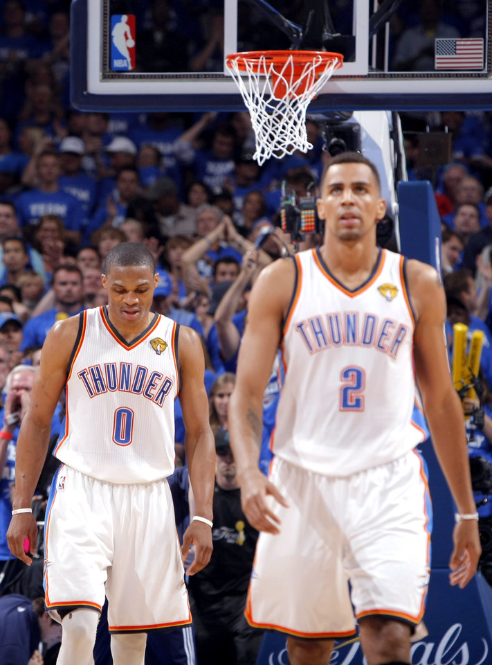 Oklahoma City's Russell Westbrook (0) and Thabo Sefolosha (2) react during Game 2 of the NBA Finals between the Oklahoma City Thunder and the Miami Heat at Chesapeake Energy Arena in Oklahoma City, Thursday, June 14, 2012. Photo by Sarah Phipps, The Oklahoman