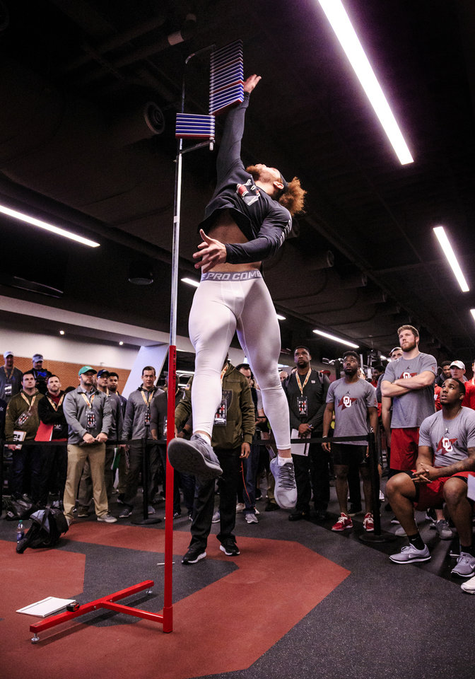Photo - Curtis Bolton records his vertical jump as he works out for NFL scouts during the University of Oklahoma football pro day at the University of Oklahoma in Norman, Okla. on Wednesday, March 13, 2019.   Photo by Chris Landsberger, The Oklahoman