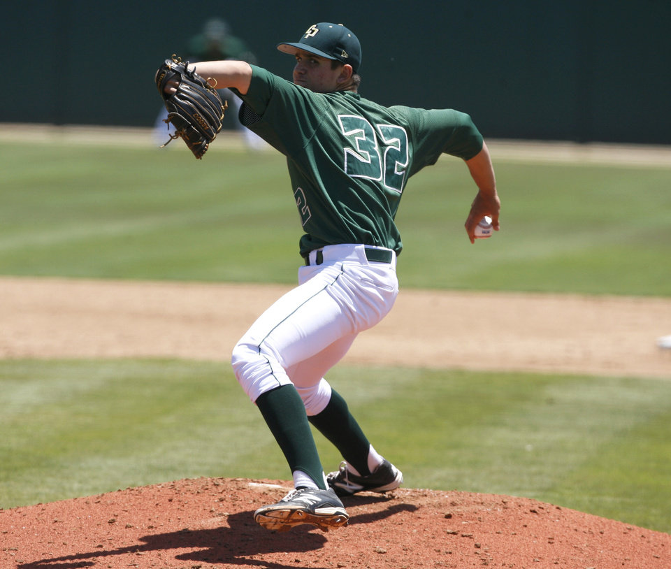 Photo - Cal Poly pitcher Justin Calomeni delivers against Sacramento State during the second inning of an NCAA college baseball tournament regional game on Sunday, June 1, 2014, at Baggett Stadium at Cal Poly in San Luis Obispo, Calif. (AP Photo/Aaron Lambert)