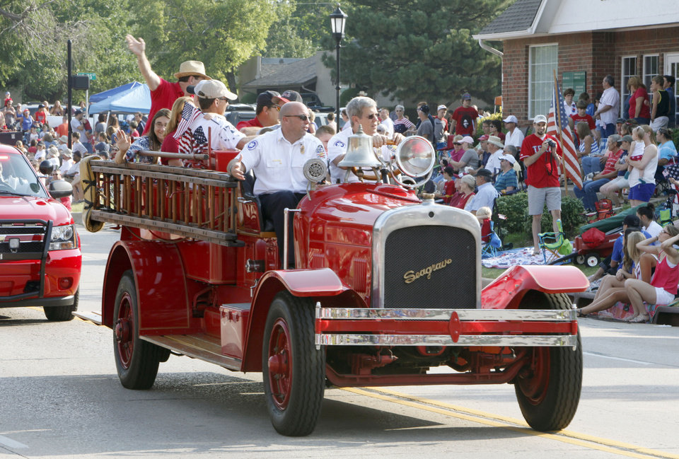 The Edmond Fire Dept. rides in the annual LibertyFest Fourth of July Parade in downtown Edmond, OK, Thursday, July 4, 2013,  Photo by Paul Hellstern, The Oklahoman