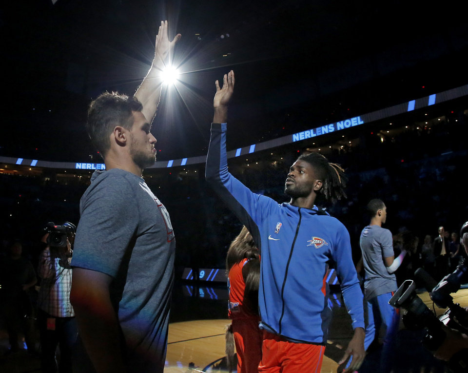 Photo - Oklahoma City's Danilo Gallinari (8) high fives Nerlens Noel (9) before the NBA game between the Oklahoma City Thunder and the Milwaukee Bucks at Chesapeake Energy Arena,   Sunday, Nov. 10, 2019.  [Sarah Phipps/The Oklahoman]