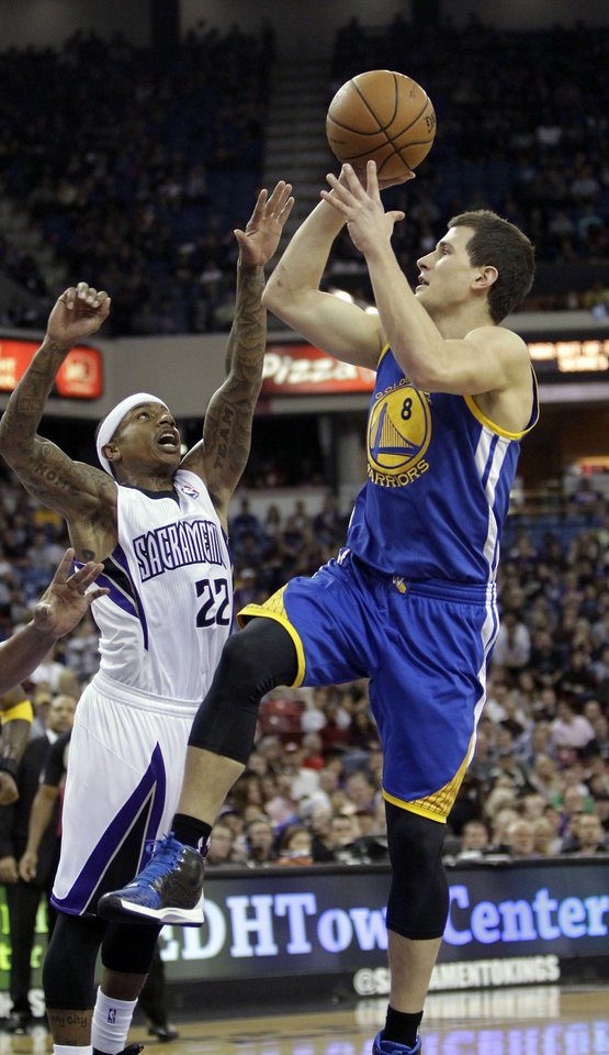 Photo - Golden State Warriors guard Nemanja Nedovic,  right, of Serbia, shoots over  Sacramento Kings guard Isaiah Thomas during the first quarter of an NBA basketball game in Sacramento, Calif., Sunday, Dec. 1, 2013. (AP Photo/Rich Pedroncelli)