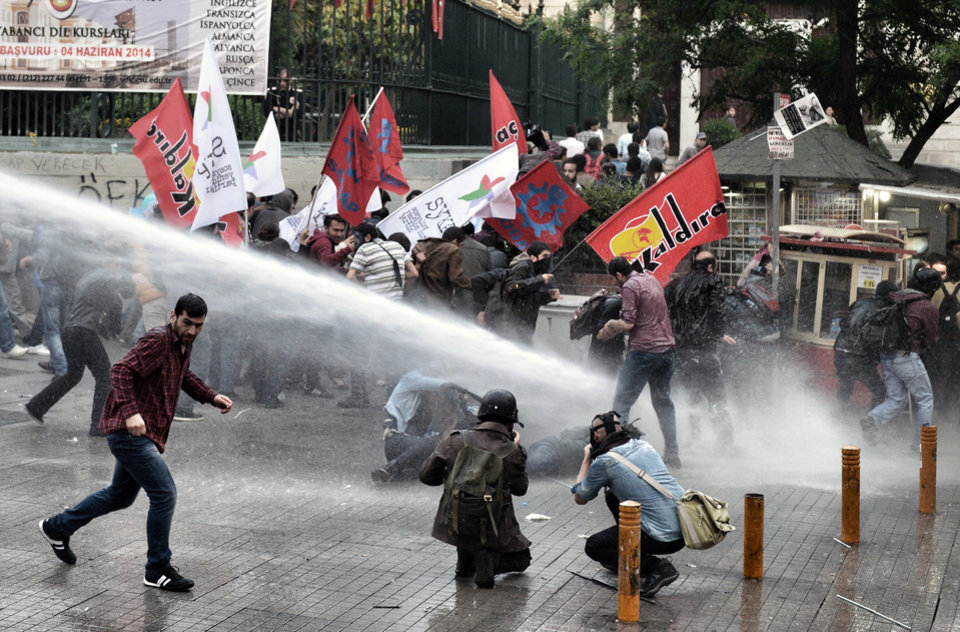 Photo - Riot police use water cannons and teargas to disperse people who were protesting the Soma mine accident that killed 301 miners, in Istanbul, Turkey, Saturday, May 17, 2014. Turkey's Energy Minister Taner Yildiz said Saturday that crews had found more bodies overnight, raising the death toll to 301. An explosion and fire at a coal mine in Soma, some 250 kilometers (155 miles) south of Istanbul, killed hundreds of workers in one of the worst mining disasters in Turkish history. (AP Photo
