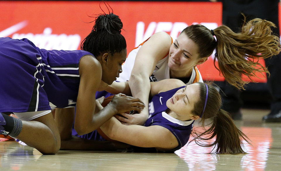 Oklahoma State's Lindsey Keller fights with TCU's Chelsea Prince, left, and Meagan Henson during a women's college basketball game between Oklahoma State University and TCU at Gallagher-Iba Arena in Stillwater, Okla., Tuesday, Feb. 5, 2013. Oklahoma State won 76-59.  Photo by Bryan Terry, The Oklahoman