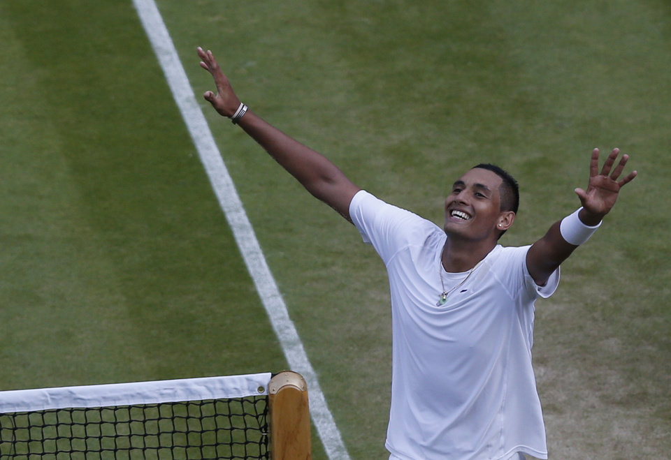 Photo - Nick Kyrgios of Australia celebrates defeating  Rafael Nadal of Spain in their men's singles match on Centre Court at the All England Lawn Tennis Championships in Wimbledon, London, Tuesday, July 1, 2014. (AP Photo/Sang Tan)