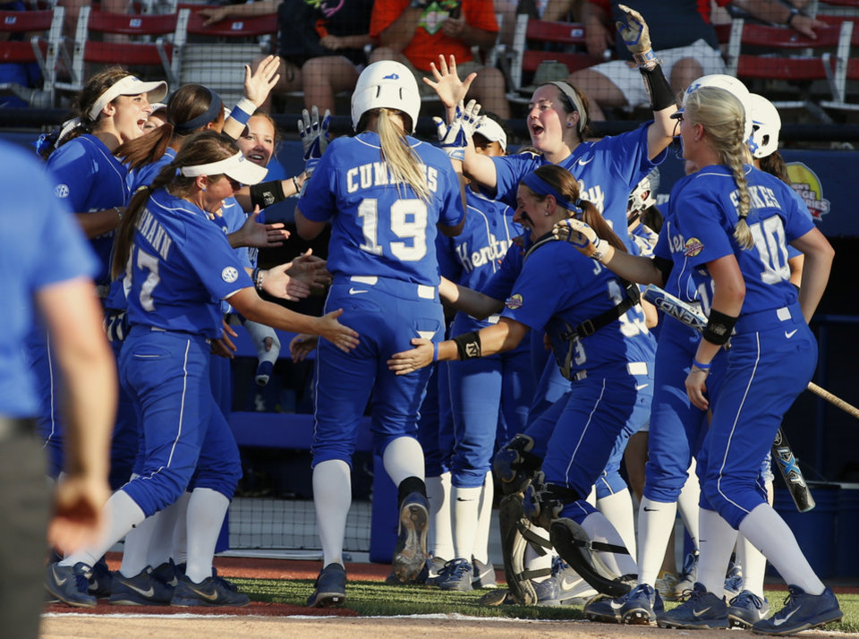 Photo - Kentucky's Lauren Cumbess celebrates with her team after hitting a home run in the fourth inning against La.-Lafayette during a Women's College World Series game between at ASA Hall of Fame Stadium in Oklahoma City Thursday, May 29, 2014. Photo by Bryan Terry, The Oklahoman
