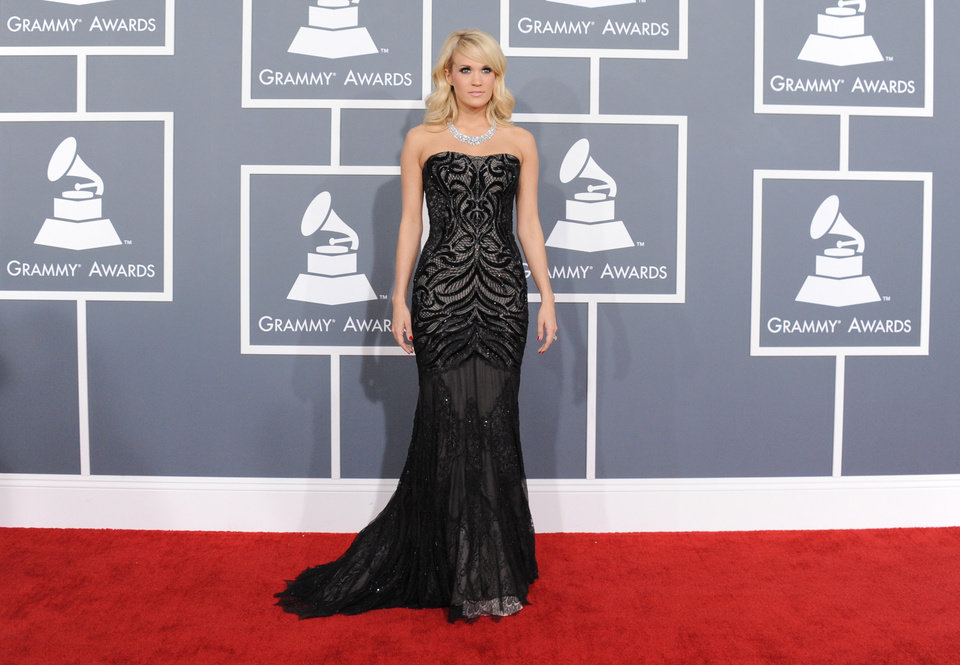 Carrie Underwood arrives at the 55th annual Grammy Awards on Sunday, Feb. 10, 2013, in Los Angeles.  (Photo by Jordan Strauss/Invision/AP) ORG XMIT: CADC242
