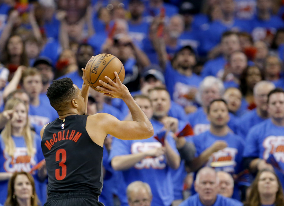 Photo - Portland's CJ McCollum (3) shoots during Game 4 in the first round of the NBA playoffs between the Portland Trail Blazers and the Oklahoma City Thunder at Chesapeake Energy Arena in Oklahoma City, Sunday, April 21, 2019.  Photo by Sarah Phipps, The Oklahoman