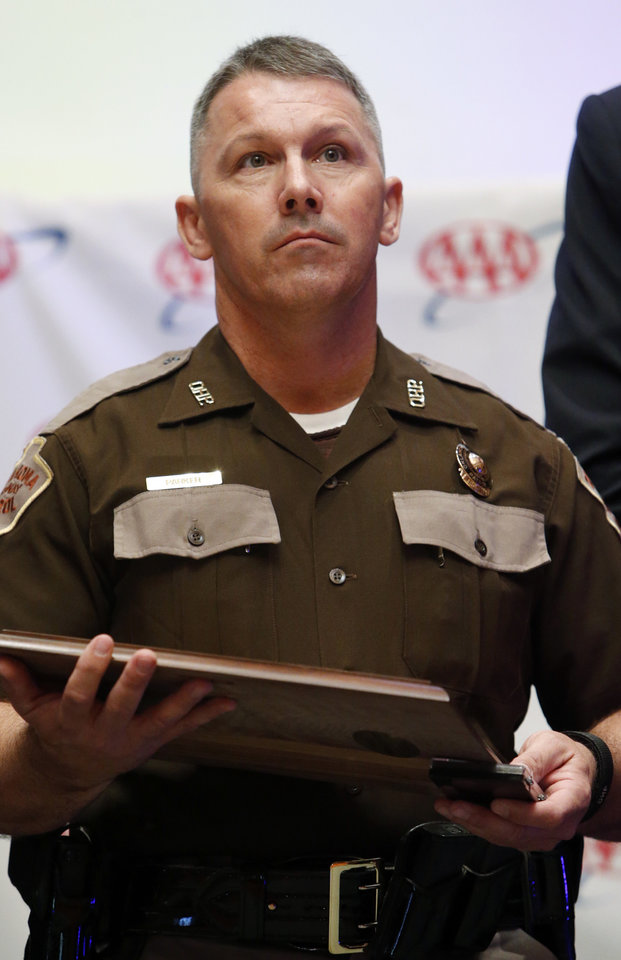 Photo -  Trooper Jeff Parker receives a Humanitarian Award — one of five Trooper of the Year Awards presented Wednesday in Norman. Photo by Steve Sisney, The Oklahoman   STEVE SISNEY -  THE OKLAHOMAN