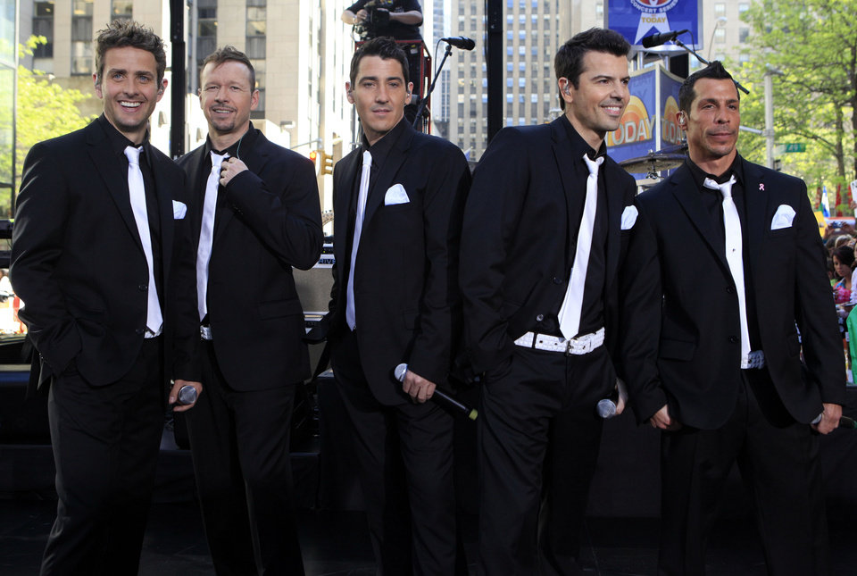Photo - FILE - This May 8, 2009 file photo shows members of New Kids on the Block, from left, Joey McIntyre, Donnie Wahlberg, Jonathan Knight, Jordan Knight, and Danny Wood on the NBC