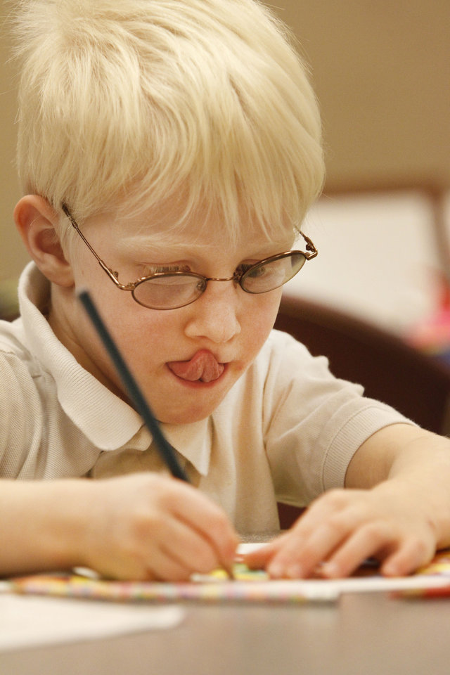 Max Bacharach, 5, works on a photo-realism art project during art camp at the Oklahoma City Museum of Art. Photo By Steve Gooch, The Oklahoman <strong>Steve Gooch - The Oklahoman</strong>