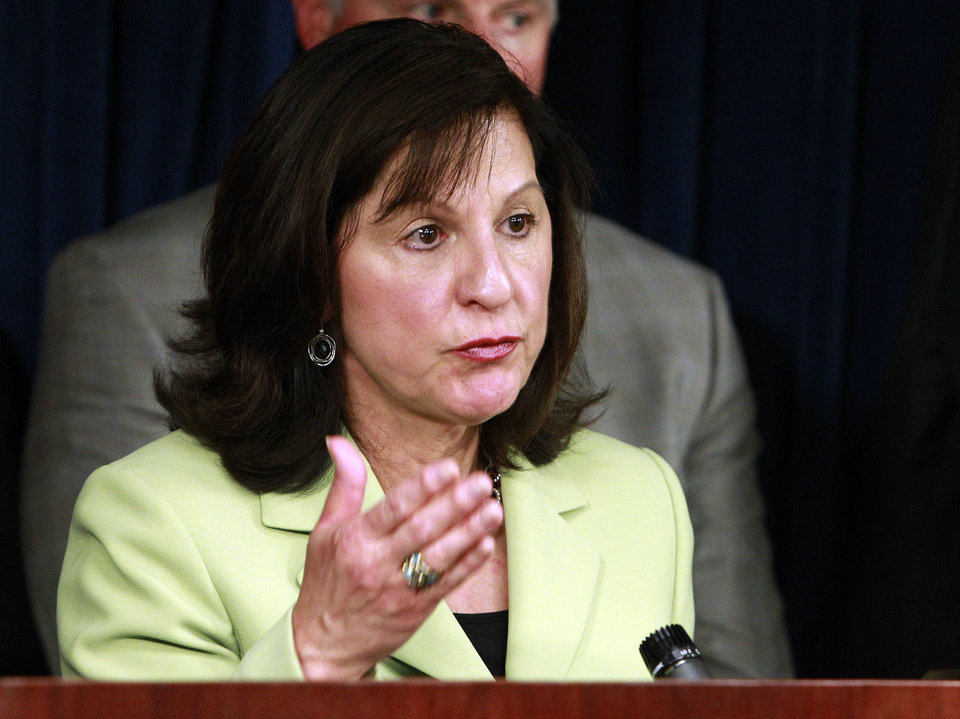 Photo - U.S. Attorney  Carmen M. Ortiz speaks during a news conference, announcing a 30-count indictment against Boston Marathon bombing suspect Dzhokhar Tsarnaev, Thursday, June 27, 2013, in Boston. Charges against Tsarnaev include using a weapon of mass destruction and bombing a place of public use, resulting in death near the marathon finish line on April 15. (AP Photo/Bill Sikes)