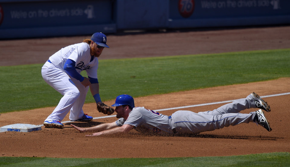 Photo - New York Mets' Daniel Murphy, right, dives into third under the tag of Los Angeles Dodgers third baseman Justin Turner on a single by David Wright during the third inning of a baseball game, Sunday, Aug. 24, 2014, in Los Angeles. (AP Photo/Mark J. Terrill)